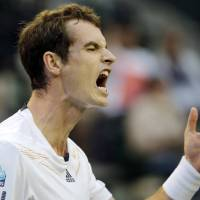 Photo -   Andy Murray of Britain reacts after missing return to Ivo Karlovic of Croatia during their first round match of the Japan Open tennis championships in Tokyo, Tuesday, Oct. 2, 2012. (AP Photo/Koji Sasahara)