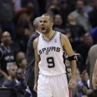 Photo - San Antonio Spurs' Tony Parker (9), of France, celebrates after he scored against the Dallas Mavericks during the second half of Game 5 of the opening-round NBA basketball playoff series on Wednesday, April 30, 2014, in San Antonio. San Antonio won 109-103. (AP Photo/Eric Gay)