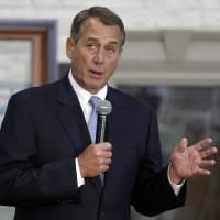 Photo - House Speaker John Boehner of Ohio takes questions from employees after a tour of Vinylmax LLC, Monday, Feb. 11, 2013, in Hamilton, Ohio. Vinylmax is a top window producing company. (AP Photo/Al Behrman)