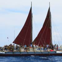 Photo - The Hokulea sailing canoe is seen off Honolulu on Tuesday, April 29, 2014. The Polynesian voyaging canoe is setting off on a 3-year voyage around the world, navigating using no modern instrumentation. (AP Photo/Sam Eifling)
