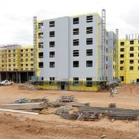 Photo -  The Embassy Suites hotel building is seen under construction Tuesday at NE 7 and Phillips Avenue in Oklahoma City.  Photos by Paul B. Southerland, The Oklahoman   PAUL B. SOUTHERLAND