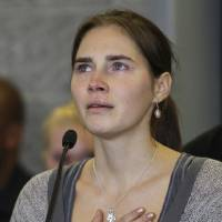 Photo - FILE - In this Tuesday, Oct. 4, 2011 file photo, Amanda Knox talks to reporters, in Seattle. A court in Florence that convicted Amanda Knox in her British roommate's 2007 murder says the wounds indicate multiple aggressors, and that the two exchange students fought over money the night of the murder. The appellate court on Tuesday, April 29, 2014, issued a 337-page explanation for its January guilty verdicts against Knox and her former boyfriend Raffaele Sollecito. Knox, 26, was sentenced to 28 ½ years while Sollecito, 30, received 25 years. Knox has been in the United States since 2011, when an earlier appellate trial that overturned her lower court conviction. Sollecito remains in Italy. The release of the court's reasoning opens the verdict to an appeal back to the supreme Court of Cassation. If the high court confirms the convictions, a long extradition fight for Knox is expected. Kercher, 21, was found dead in a pool of blood in the apartment she and Knox shared in the town of Perugia. (AP Photo/Ted S. Warren, File)