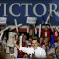 Photo -   Republican presidential candidate, former Massachusetts Gov. Mitt Romney steps on stage to speak at a campaign event at the Iowa Events Center Sunday, Nov. 4, 2012, in Des Moines, Iowa. (AP Photo/David Goldman)