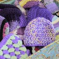 Photo - Penny Hill-Malone and Aimee Merick crochet purple caps for the