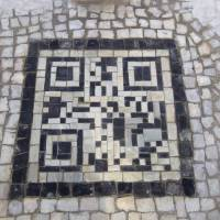 Photo - A QR codes made of the black and white stones covers a sidewalk near the beach in Rio de Janeiro, Brazil, Friday, Jan. 25, 2013. The QR codes are being placed at tourist spots which can be scanned with a mobile device for information about the site. (AP Photo/Silvia Izquierdo)
