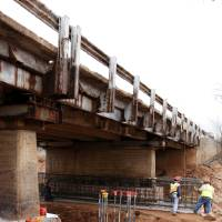 Photo - Contractors are replacing four piers on the Sooner Road Bridge. The bridge was closed in September for emergency repairs. PHOTOS BY PAUL B. SOUTHERLAND, THE OKLAHOMAN