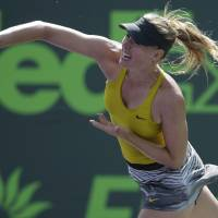 Photo - Maria Sharapova, of Russia, serves to Kirsten Flipkens, of Belgium, at the Sony Open tennis tournament, Monday, March 24, 2014, in Key Biscayne, Fla. (AP Photo/Lynne Sladky)