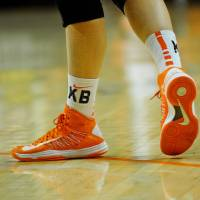 Photo - Oklahoma State sophomore guard Liz Donohoe's shoes are taped with the letters KB and MS to honor Kurt Budke and Miranda Serna, the two coaches killed in a plane crash one year ago on November 17, 2011. KT King/For the Tulsa World