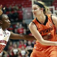 Photo - Texas Tech's Chynna Brown (00) defends against Oklahoma State's Liz Donohoe during their NCAA college basketball game in Lubbock, Texas, Wednesday, Feb. 27, 2013. (AP Photo/The Avalanche-Journal, Stephen Spillman)