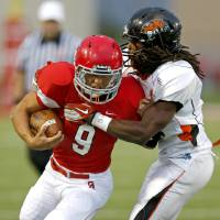 Photo - Carl Albert's Caleb Toney tries to get past Coweta's Jakeem Johnson during a high school football game at Carl Albert in Midwest City, Friday, September 7, 2012. Photo by Bryan Terry, The Oklahoman