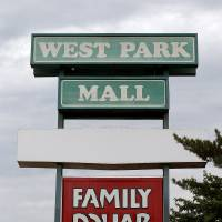Photo - The mid-1970s lettering on the West Park Mall sign is an indication that the property has not seen much in the way of improvement since it was built in 1974. The new owner plans to redevelop the 124,955-square-foot shopping center into new retail at NW 63 and MacArthur Boulevard in Warr Acres.  BRYAN TERRY - THE OKLAHOMAN