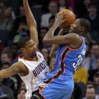 Photo - Thunder forward Kevin Durant shoots during OKC's 99-81 win Tuesday in Charlotte. AP PHOTO