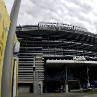 Photo - A banner is seen outside MetLife Stadium Monday Jan. 27, 2014, in East Rutherford, N.J. The stadium will host   Sunday's NFL Super Bowl XLVIII football game between the Denver Broncos and the Seattle Seahawks. (AP Photo/Charlie Riedel)
