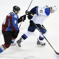 Photo - Colorado Avalanche center Matt Duchene, left, tries to catch St. Louis Blues center Patrik Berglund, right, in the first period of an NHL hockey game on Saturday, March 8, 2014, in Denver. (AP Photo/Chris Schneider)