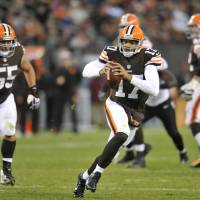 Photo - Cleveland Browns quarterback Jason Campbell runs against the Baltimore Ravens in the second quarter of an NFL football game Sunday, Nov. 3, 2013. (AP Photo/David Richard)