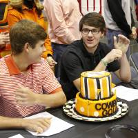 Photo - Hayden Wood, left, and Nick Heinen signed as golfers with OSU. Athletes from Edmond North High School signed national letters of intent with colleges and universities during a ceremony in the school's gymnasium Wednesday morning, Nov. 13, 2013. Various sports include golf, softball, wrestling,  lacrosse and others. Photo by Jim Beckel, The Oklahoman