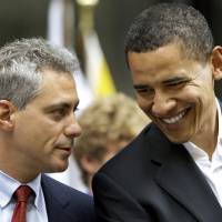 Photo - ** FILE **     PRESIDENT / PRESIDENT-ELECT: In this  June 6, 2008,, file photo Rep. Rahm Emanuel, D-Ill., left, talks with then-Democratic presidential candidate Sen. Barack Obama D-Ill. in Chicago. Barack Obama's fellow Chicagoan Rahm Emanuel, the hard-charging No. 3 Democrat in the House, has accepted the job White House chief of staff, Democratic officials said Thursday, Nov. 6, 2008.  (AP Photo/Alex Brandon, File) ORG XMIT: WX108