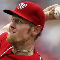Photo -   Washington Nationals starting pitcher Stephen Strasburg throws during the second inning of a baseball game with the St. Louis Cardinals at Nationals Park, Sunday, Sept. 2, 2012, in Washington. (AP Photo/Alex Brandon)