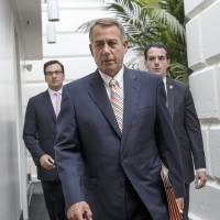Photo - Speaker of the House John Boehner of Ohio, arrives for a meeting of the Republican Conference on Capitol Hill in Washington, Tuesday, July 29, 2014. (AP Photo/J. Scott Applewhite)