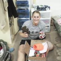 Photo - Military service member Katie Fichtner receives a care package from The Hugs Project.   - photo provided