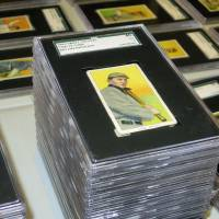 Photo - In this Aug. 25, 2014 photo, a 1909 baseball card depicting Ty Cobb is seen at Saco River Auction Co., in Biddeford, Maine. The card is part of a collection of more than 1,400 baseball cards from 1909, 1910 and 1911 that will be auctioned off starting in January 2015. (AP Photo/David Sharp)