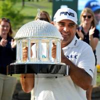 Photo - Angel Cabrera holds up The Greenbrier Classic Springhouse Trophy after winning the Greenbrier Classic golf tournament at the Greenbrier Resort in White Sulphur Springs, W.Va., Sunday, July 6, 2014.  (AP Photo/Chris Tilley)
