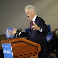 Photo -   Former President Bill Clinton speaks to a packed crowd at Indian River High School in Chesapeake, Va. on Saturday, Nov. 3, 2012. (AP Photo/The Virginian-Pilot, Amanda Lucier) MAGS OUT