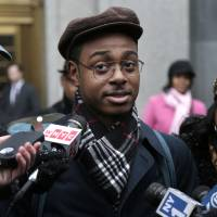 Photo - Devin Almonor speaks to members of the media after testifying in a civil trial regarding police stop and frisk tactics in New York, Monday, March 18, 2013. A civil trial that began Monday in federal court in Manhattan will examine the controversial tactic that has become a city flashpoint, with mass demonstrations, City Council hearings and mayoral candidates calling for reform. The lawsuit, now a class-action, seeks a court-appointed monitor to oversee changes to how the police make stops. (AP Photo/Seth Wenig)