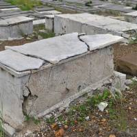Photo - In this Nov. 12, 2012 photo, a crumbling tomb stands in the Beth Haim cemetery in Blenheim on the outskirts of Willemstad, Curacao. AP photo  Karen Attiah