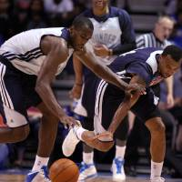 Photo - OKC players Serge Ibaka (left) and Daequan Cook battle for a loose ball during the Blue-White scrimmage at the SpiritBank Event Center, on Thursday, Oct. 18, 2012. CORY YOUNG/Tulsa World