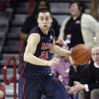 Photo - In this Wednesday, March 5, 2014 photo, Mississippi guard Marshall Henderson dribbles the ball in the second half of an NCAA college basketball game against Arkansas in Fayetteville, Ark. Henderson, a former Mississippi basketball player, said ESPN's coverage of Michael Sam becoming the first openly gay player drafted by the NFL was inappropriate and that he is boycotting SportsCenter. (AP Photo/Danny Johnston)