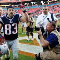 Photo - New England Patriots wide receiver Wes Welker (83) gestures to fans as he leaves the field after their 23-16 win in an NFL football game, Sunday, Dec. 2, 2012, in Miami. Welker tied Jerry Rice's NFL record by making at least 10 receptions for the 17th time. He had 12 catches for 103 yards and a score. (AP Photo/Wilfredo Lee)