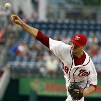 Photo - Washington Nationals starting pitcher Doug Fister throws during the first inning of a baseball game against the New York Mets at Nationals Park Wednesday, Aug. 6, 2014, in Washington. (AP Photo/Alex Brandon)