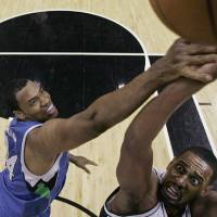 Photo - FILE - In a March 17, 2009, file photo Minnesota Timberwolves center Jason Collins, left, defends San Antonio Spurs center Kurt Thomas during the first quarter of an NBA basketball game in San Antonio. A person familiar with the situation says Jason Collins and the Brooklyn Nets are meeting in California and he could sign with the team on Sunday Feb. 23, 2014.   (AP Photo/Eric Gay, file)