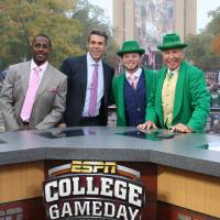 Photo -  ESPN's College GameDay Crew Desmond Howard and Chris Fowler with the Notre Dame Leprechaun and Lee Corso dressed up like the Leprechaun. (Photo courtesy of Tammie Burton)