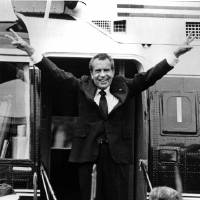 Photo - FILE - In this Aug. 9, 1974 file photo, Richard Nixon waves goodbye with a salute to his staff members outside the White House as he boards a helicopter and e resigns the presidency on Aug. 9, 1974. He was the first president in American history to resign the nation's highest office. (AP Photo, File)