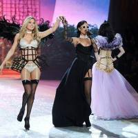 Photo - Singer Rihanna, right, performs while model Doutzen Kroes walks the runway during the 2012 Victoria's Secret Fashion Show on Wednesday Nov. 7, 2012 in New York. The show will be Broadcast on Tuesday, Dec. 4 (10:00 PM, ET/PT) on CBS. (Photo by Evan Agostini/Invision/AP)