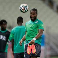 Photo - Ivory Coast's Didier Drogba heads a ball during on official training session the day before the group C World Cup soccer match between Greece and Ivory Coast at the Arena Castelao in Fortaleza, Brazil, Monday, June 23, 2014. Ivory Coast should beat Group C strugglers Greece, but even a draw won't hold them back as long as Japan doesn't upset Colombia. (AP Photo/Fernando Llano)