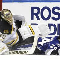 Photo - Tampa Bay Lightning right wing Ryan Callahan (24) takes down Boston Bruins goalie Tuukka Rask, of Finland, during the first period of an NHL hockey game on Saturday, March 8, 2014, in Tampa, Fla. Callahan was tripped and slid into Rask. (AP Photo/Chris O'Meara)