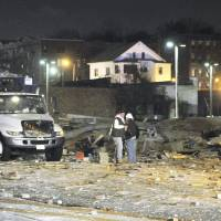 Photo -   Gas company workers stand where a building once stood, which was leveled by an explosion in downtown Springfield, Mass. on Friday, Nov. 23, 2012. (AP Photo/Springfield Republican, Don Treeger) MANDATORY CREDIT