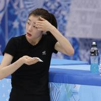 Photo - Yuna Kim of South Korea wipes her face during a practice session at the Iceberg Skating Palace during the 2014 Winter Olympics, Sunday, Feb. 16, 2014, in Sochi, Russia. (AP Photo/Darron Cummings)