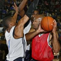 Photo - NBA BASKETBALL: Michael Ruffin, right, is shut down by Russell Westbrook and Kevin Durant during the Oklahoma City Thunder 2009 Community Practice at Midwest City High School on Monday, Oct. 6, 2009, in Midwest City, Okla.  Photo by Chris Landsberger, The Oklahoman. ORG XMIT: KOD