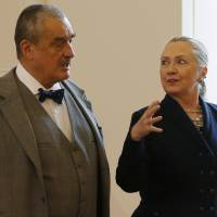 Photo - Czech Republic's Foreign Minister Karel Schwarzenberg, left, and US Secretary of State Hillary Rodham Clinton, right, arrive for their press conference in Prague, Czech Republic, Monday, Dec. 3, 2012.  Secretary of State Clinton is lobbying the Czech Republic authorities to approve an American contract bid for an expansion of a nuclear power plant. (AP Photo/Petr David Josek)