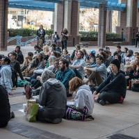 Photo - An overflow crowd watches the City Council meeting outside City Hall Monday evening, April 7, 2014, in Albuquerque, NM. (AP Photo/Albuquerque Journal, Roberto Rosales)
