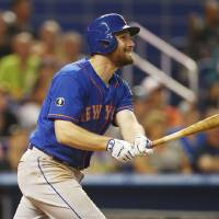 Photo - New York Mets' Daniel Murphy smiles as he hits a three-run home run during the fourth inning of a baseball game against the Miami Marlins, Sunday, June 22, 2014, in Miami.  (AP Photo/J Pat Carter)