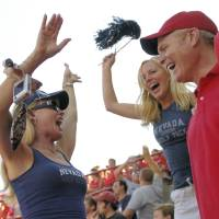 Photo - COLLEGE FOOTBALL / FANS / JULIE KEALY / MIKE KEALY: Nevada vs. Nebraska at Memorial Stadium (Lincoln) September 1, 2007 -- Karen Kealy, left, and daughter Julie celebrate Nevada's first half touchdown while husband and father Mike enjoys the moment with them. The Kealy's live in Nevada, but Mike graduated from UNL.   HEIDI HOFFMAN/Lincoln Journal Star  ***NO SALES, NO MAGS***  9/2/2007 pg 1B Karen Kealy (left) and daughter Julie celebrate Nevada's first-half touchdown while husband and father Mike enjoys the moment with them. The Kealys live in Nevada, but Mike graduated from the University of Nebraska at Omaha after transferring from Lincoln. ORG XMIT: 0911062217313034