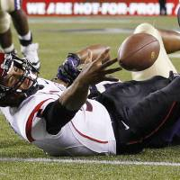 Photo -   San Diego State quarterback Ryan Katz loses the ball while being brought down on the one-yard line on a run against Washington in the second half of an NCAA college football game on Saturday, Sept. 1, 2012, in Seattle. Washington won 21-12. (AP Photo/Elaine Thompson)