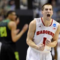 Photo - Wisconsin guard Ben Brust (1) reacts during the first half of an NCAA college basketball tournament regional semifinal against Baylor, Thursday, March 27, 2014, in Anaheim, Calif. (AP Photo/Mark J. Terrill)