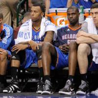Photo - Oklahoma City's Eric Maynor, left, Daequan Cook, Nazr Mohammed, and Nick Collison sit on the bench during game 1 of the Western Conference Finals in the NBA basketball playoffs between the Dallas Mavericks and the Oklahoma City Thunder at American Airlines Center in Dallas, Tuesday, May 17, 2011. Photo by Bryan Terry, The Oklahoman