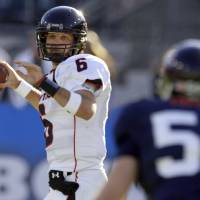 Photo - Texas Tech University quarterback Graham Harrell (6) looks pass down field against Virginia during the Gator Bowl college football game, Tuesday Jan. 1, 2008 in Jacksonville, Fla. (AP Photo/Stephen Morton) ORG XMIT: FLSM107